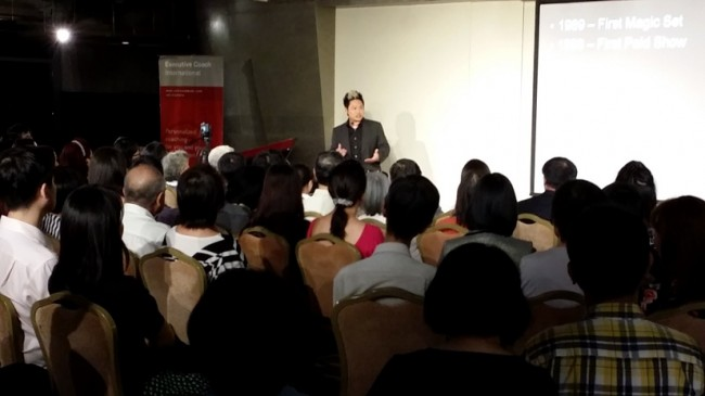 Picture of J C Sum, giving Passion Unleashed Talk at Singapore Management University on business and challenges of a performing artiste.